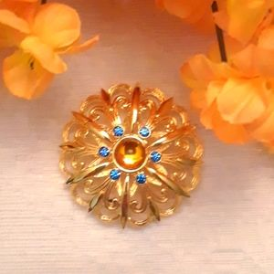JJ Brooch with Gold Glass Cabochon and Blue Stones